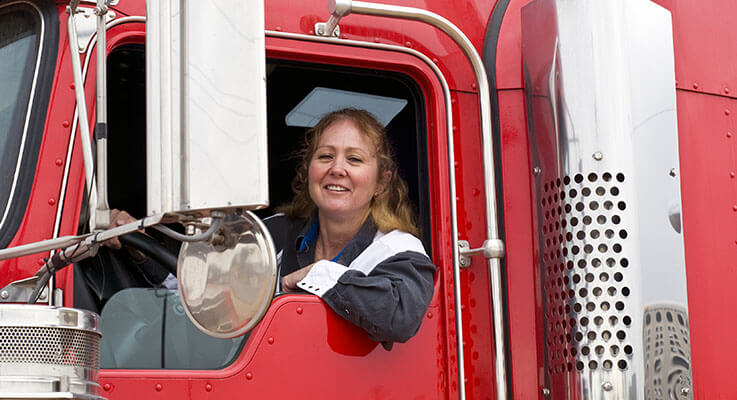 truck driver looking out of her semi truck window