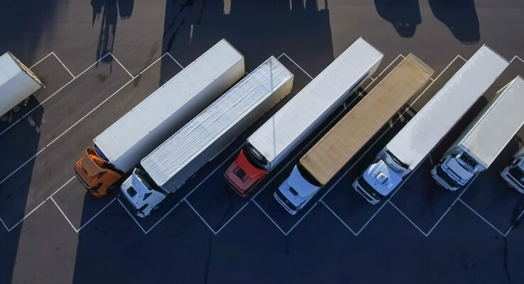 Aerial view of semi trucks at a leasing company